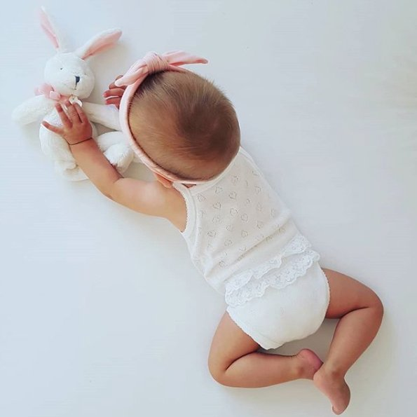 childrens clothing image cute baby play with toy rabbit